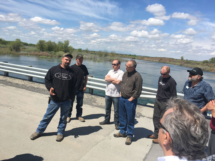 Kittitas County Commissioner Paul Jewell, Okanogan County Commissioner Chris Branch, Asotin County Commissioner Paul Jewell, and WSAC Program Consultant Neil Aaland listen to representatives from the Moses Lake Dam discuss recently replaced dam project.
