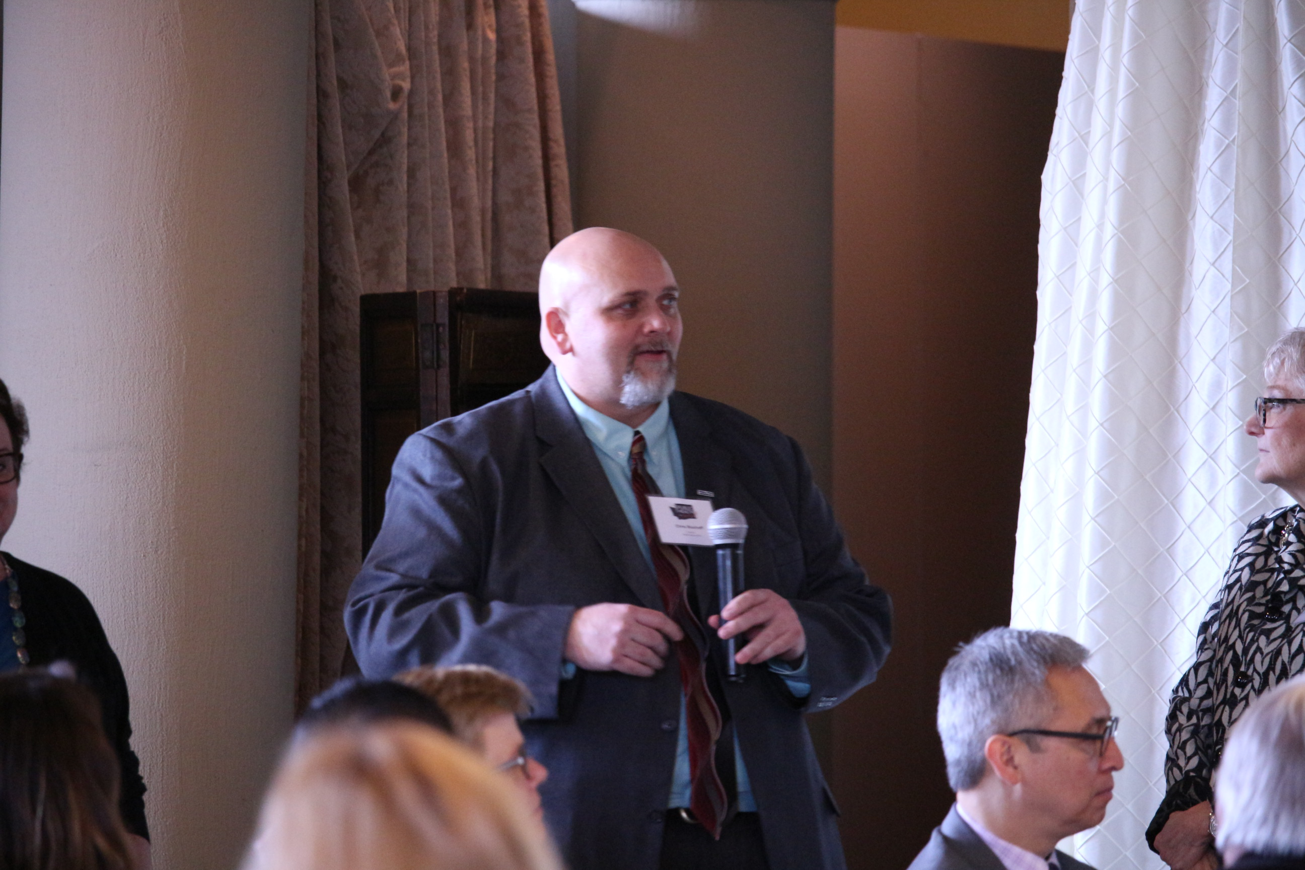 Chris Bischoff (Wahkiakum County) addresses participants